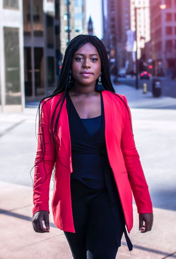 female CEO walking in red blazer during coronavirus financial crisis
